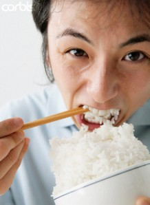 Man Eating Rice